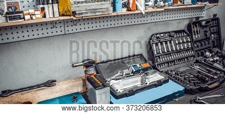 Inside Workshop. Large Workbench And Tools Kit For Working On Table Close-up. Workspace For Mechanic