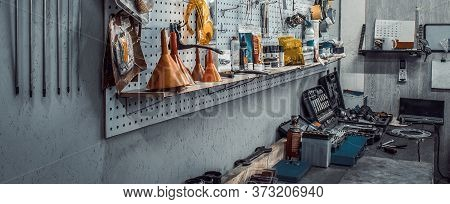 Workbench With Sets Of Keys Box, Screwdrivers, Electrical Tape On Wall. Moto Workshop With Hand Mech