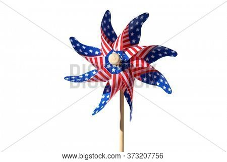 American Flag Pin Wheel. Isolated on white. Room for text. Red, White and Blue Pin Wheel. Independence Day prop. 4th of July Pin Wheel.