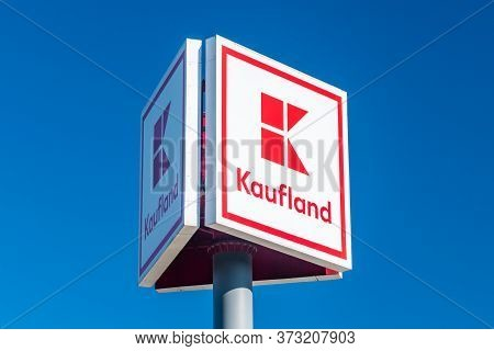 Mragowo, Poland - June 1, 2020: Logo Of Kaufland Shop On Blue Sky. Kaufland Is A German Internationa