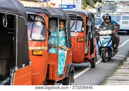 Galle, Sri Lanka - February 18th, 2019: A Local Sri Lankan Woman, Sitting Onboard A Tuk Tuk At Matar