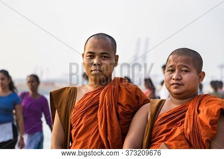 Colombo, Sri Lanka - February 19, 2019: Two Buddhist Monks With Orange Clothes Looking Camera In Col