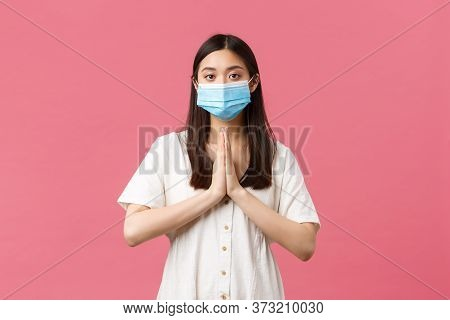 Covid-19, Social Distancing, Virus And Lifestyle Concept. Hopeful Cute Asian Girl In Medical Mask As