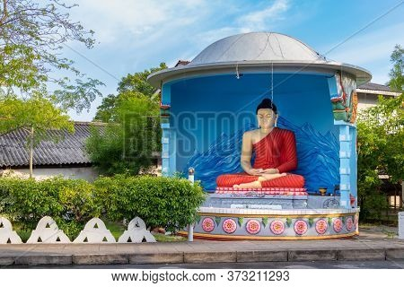 Galle, Sri Lanka - February 17th, 2019: A Statue Of Buddha In Memory Ch Windsor Placed Next To The P