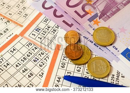 Winning The Lottery. Euro Banknotes And Coins Are On Lottery Tickets.