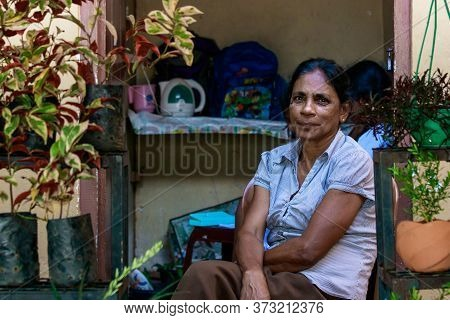 Galle, Sri Lanka - February 18th, 2019: Portrait Of A Sri Lankan Woman Sitting, Waiting For Customer