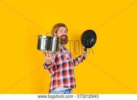 Kitchenware. Bearded Man With Saucepan Frypan. Man Chef With Pot. Saucepan. Cooking. Cooking Utensil