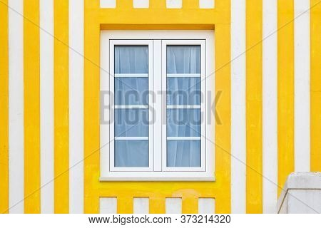 Colored Window In Typical Small Wooden House With Colorful Stripes In Costa Nova, Aveiro, Portugal.