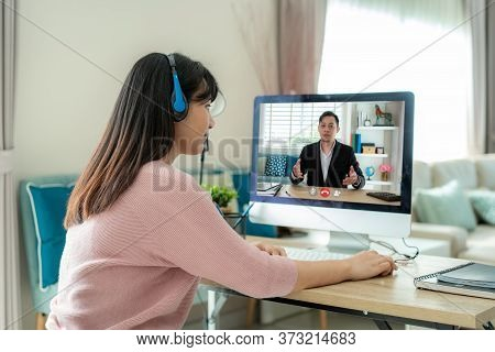 Businesswoman Making Video Call To Business Partner Using Computer. Close-up Rear View Of Young Woma