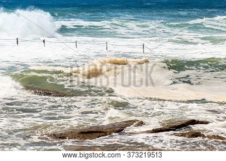Rock Pool At Cronulla, Nsw, Australia At High Tide Following Storm Weather.