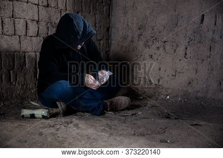 Man Hand Holds Plastic Packet Or Bag With Drug