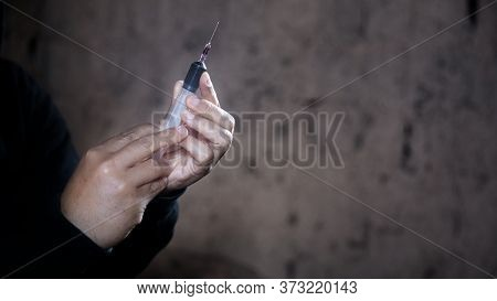 Syringe For Injection With Medicine In Hands