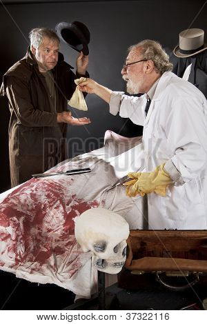 Evil Doctor Reaches Over Bloody Corpse And Pays Graverobber