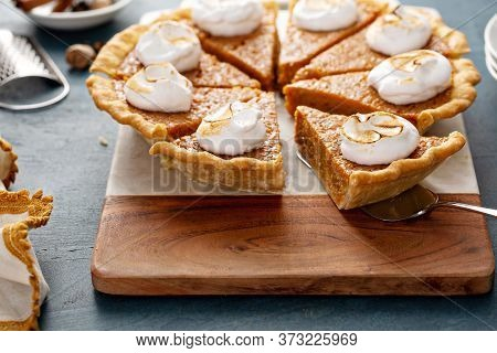 Sweet Potato Pie With Marshmallow Fluff Topping Sliced On A Board