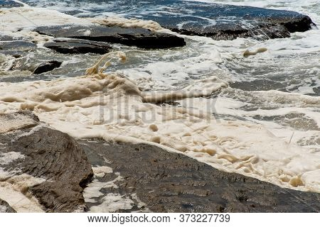 Ocean Storm Aftermath: A Mass Of Thick Foam Covered The Rocks Following Extreme Storm Weather At Cro