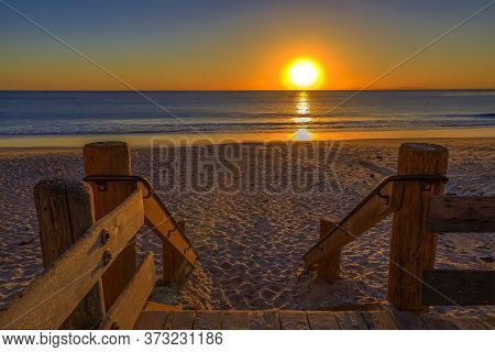 Incredible Colors Of Sunset In Laguna Beach, Famous Tourist Destination In California, Usa With Wood