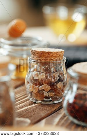 Glass Jar Of Sweetener On Wooden Table
