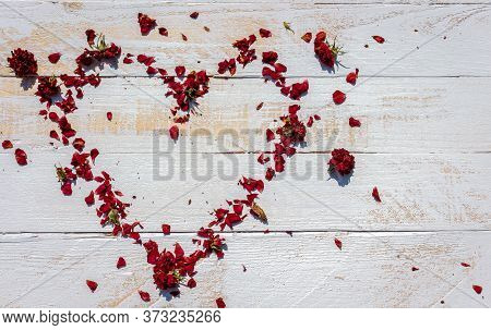 Red Rose Wither Petals Heart On White Wood Ground With Copy Space,abstract Background,old Love But U