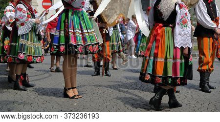Local People In Traditional Folk Costumes From Lowicz, Poland, While Join Corpus Christi Procession