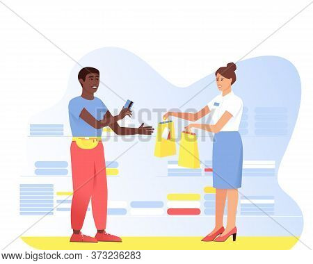 An African American Is Shopping At A Shop Assistant. A Man Pays With A Card For A Purchase. Seller H