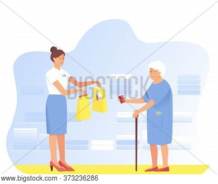Aged Woman Makes Purchases From The Seller In The Store. Grandma Pays With A Card For The Purchase.