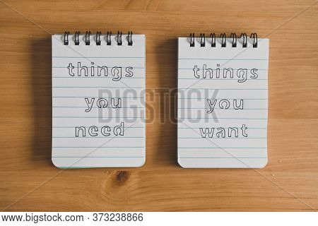 Notepads With Titles Things You Need Vs Things You Want Side By Side On Desk Ready For Meditation