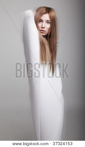 Airy Young Girl In White Clothes Posing In Studio