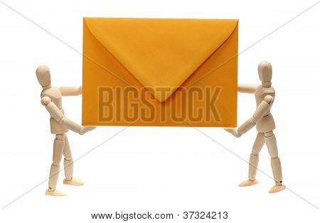 Two Wooden Dolls Holding Yellow Envelope