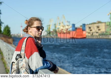 A Girl Alone In A Commercial Seaport On A Walk. Russia, Saint Petersburg, May 30, 2020