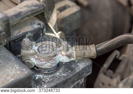Oxidized And Dirty Car Battery Terminal. Car Checkup Repair Concept