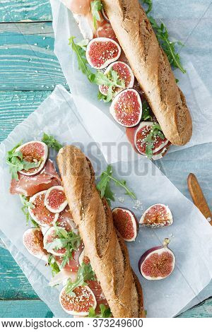 Top View Sandwich Prosciutto Mascarpone Cheese Figs Wooden Table