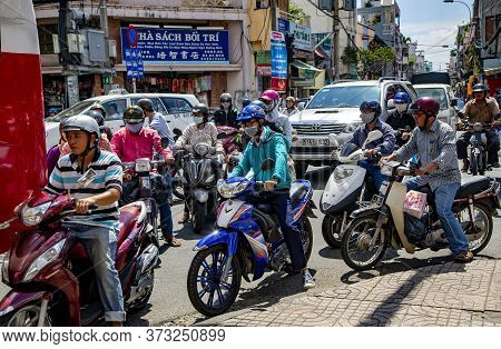 Asia, Vietnam, Hochiminh, November, 15, 2014 - Vietnamese Morning Traffic On Motorbikes  In The Stre