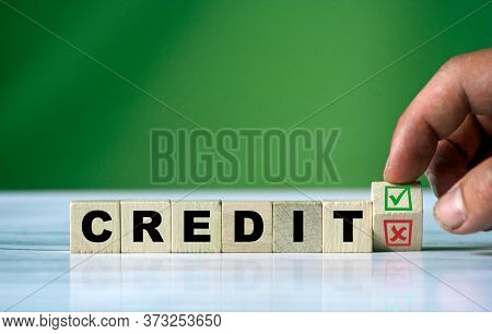 The Hand Turns The Wooden Cube And Changes The Word Credit With Green Positive Tick Check Box And Re