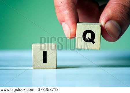 Iq Word Concept On Wooden Cube.  Intelligence Symbol. Brain Or Talent Background.