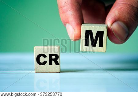 Crm Symbol. Word Crm On Wooden Cube. Hand Hold One Cube.