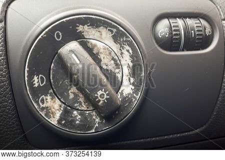 Old And Damaged  Car Light Switch. Background