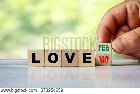 The Hand Turns The Wooden Cube And Changes The Word No Love To Yes Love