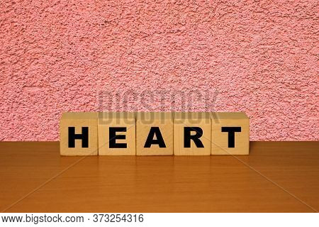 Heart Message Word On A Wooden Desk On Cube Blocks With Red Background
