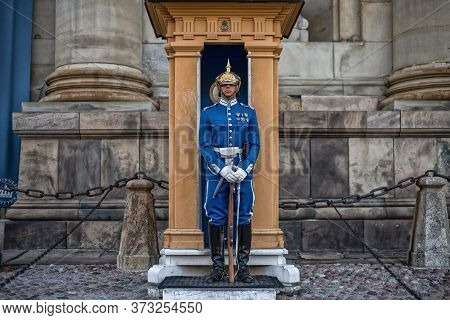 Stockholm, Sweden - August 3, 2019: Sweden Royal Guard In Blue Uniform Protecting Royal Palace In St