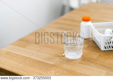 Close Up Glass With Water And Sparkling Pill. Magnesium Anti-stress, Painkiller Or Orange Drink