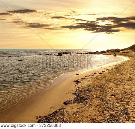 golden sunset on the coast and mediterranean sea of Sicily in summer touristic natural landmark
