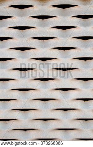 Grey Painted Aluminium Rusty Iron Wall With Many Openings