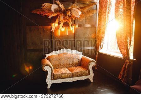Floral Arrangement And Edison Lamps On Wood Background