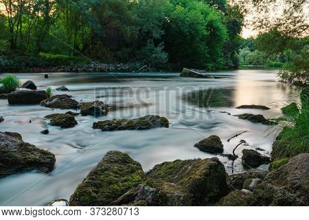 A Picturesque River Stream In A Green Forest And Rocky Terrain. Minho, Galicia.