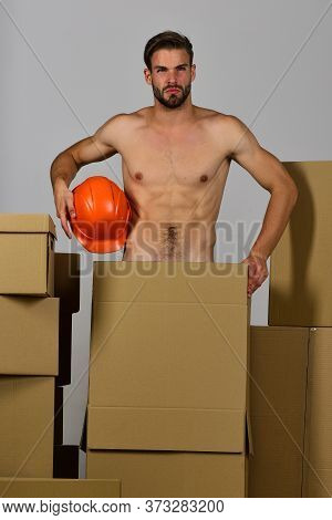 Macho With Bristle And Puzzled Face Holding Orange Engineers Helmet