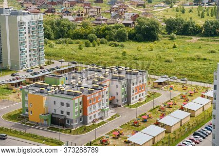 Aerial View Exterior Public Housing Hdb Resident Buildings, New Multistory Flats Complex With Grass