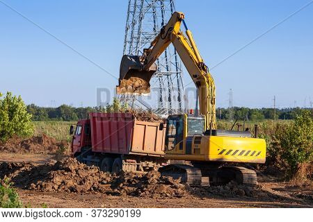 Dump truck and excavator on the construction site