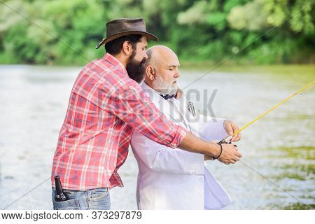 Personal Instructor. Bearded Man And Elegant Businessman Fish Together. Learn To Fish. Fish With Com