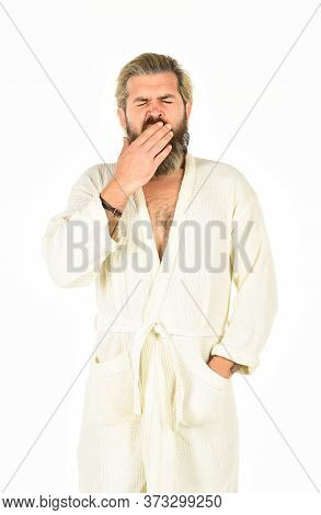 Slept Well. Rest At Home. Feeling Good. Hipster With Long Hair And Beard In Bathrobe White Backgroun