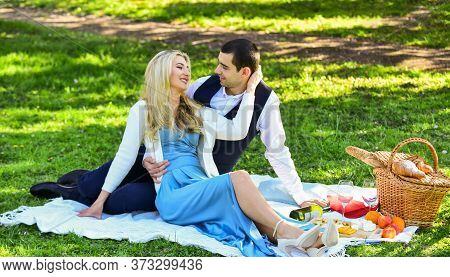 Celebrate Love. Vintage Style. Couple In Love Enjoying Picnic Time And Food Outdoors. Man And Woman